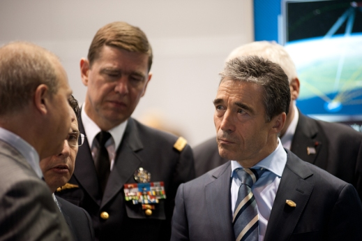 NATO Secretary General Rasmussen meets with military officers and other officials at the 2012 NATO Summit in Chicago.